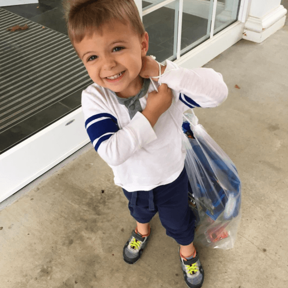 kimberlyadra Proud of this little man who did such a great job picking out gifts for the Salvation Army Angel he sponsored. Before we picked our